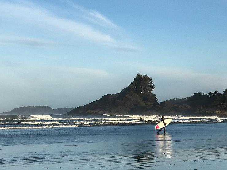 surfer on cox bay tofino bc